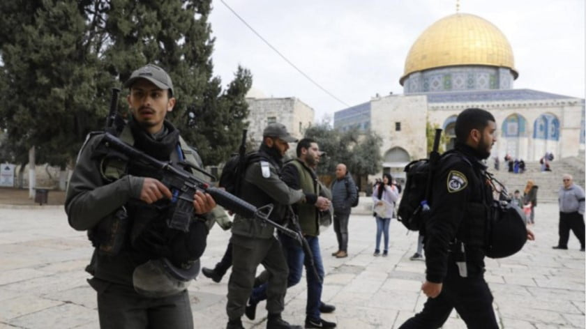 Israeli police detain a Palestinian demonstrator at al-Aqsa Mosque compound in Jerusalem's Old City on 18 February (AFP)