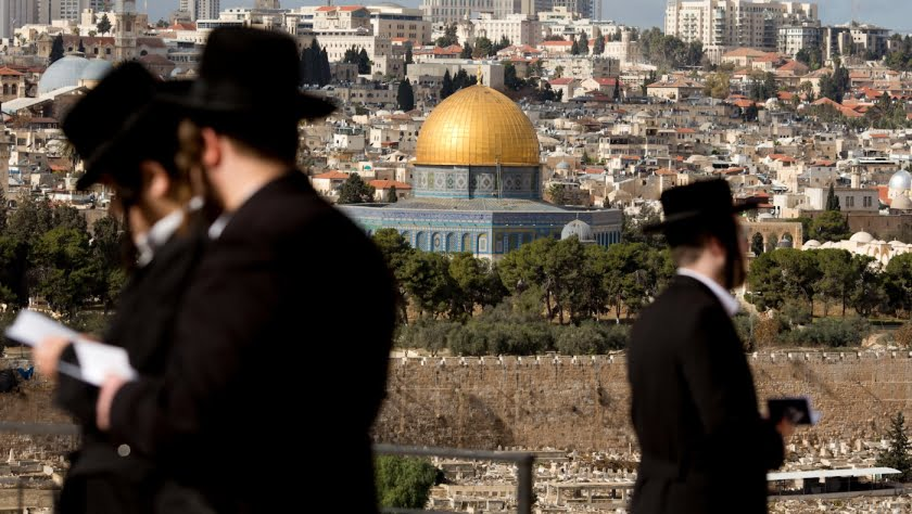 The Dome of the Rock Mosque in the Al-Aqsa Mosque compound in Jerusalem's Old City is seen while Jewish orthodox men pray in a cemetery in Jerusalem, Dec. 7, 2017, a day after U.S. President Donald Trump's recognition of Jerusalem as Israel's capital. Ariel Schalit | AP