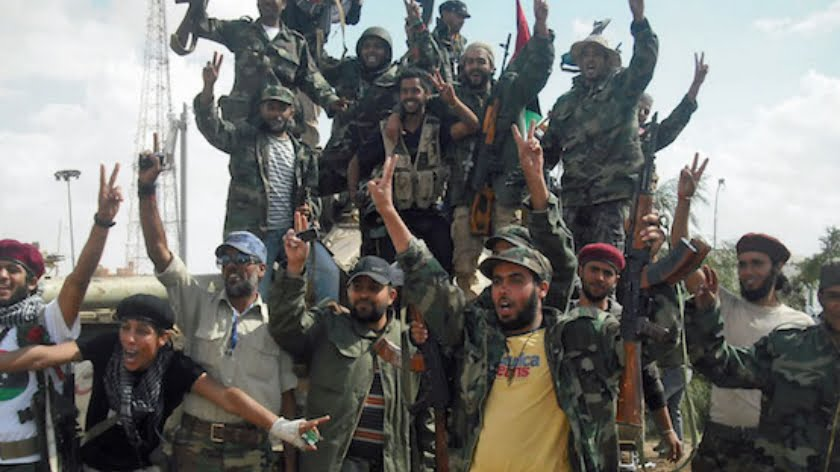 Fighters for Libya's interim government rejoice after a tactical victory back in 2011. Creative Commons