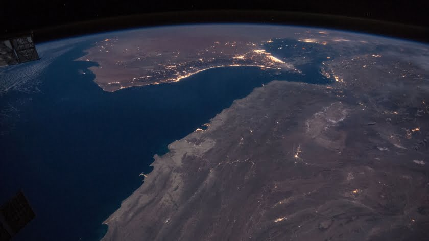 Night view of coast of Oman, including Strait of Hormuz. (Intl Space Station photo via Wikimedia)