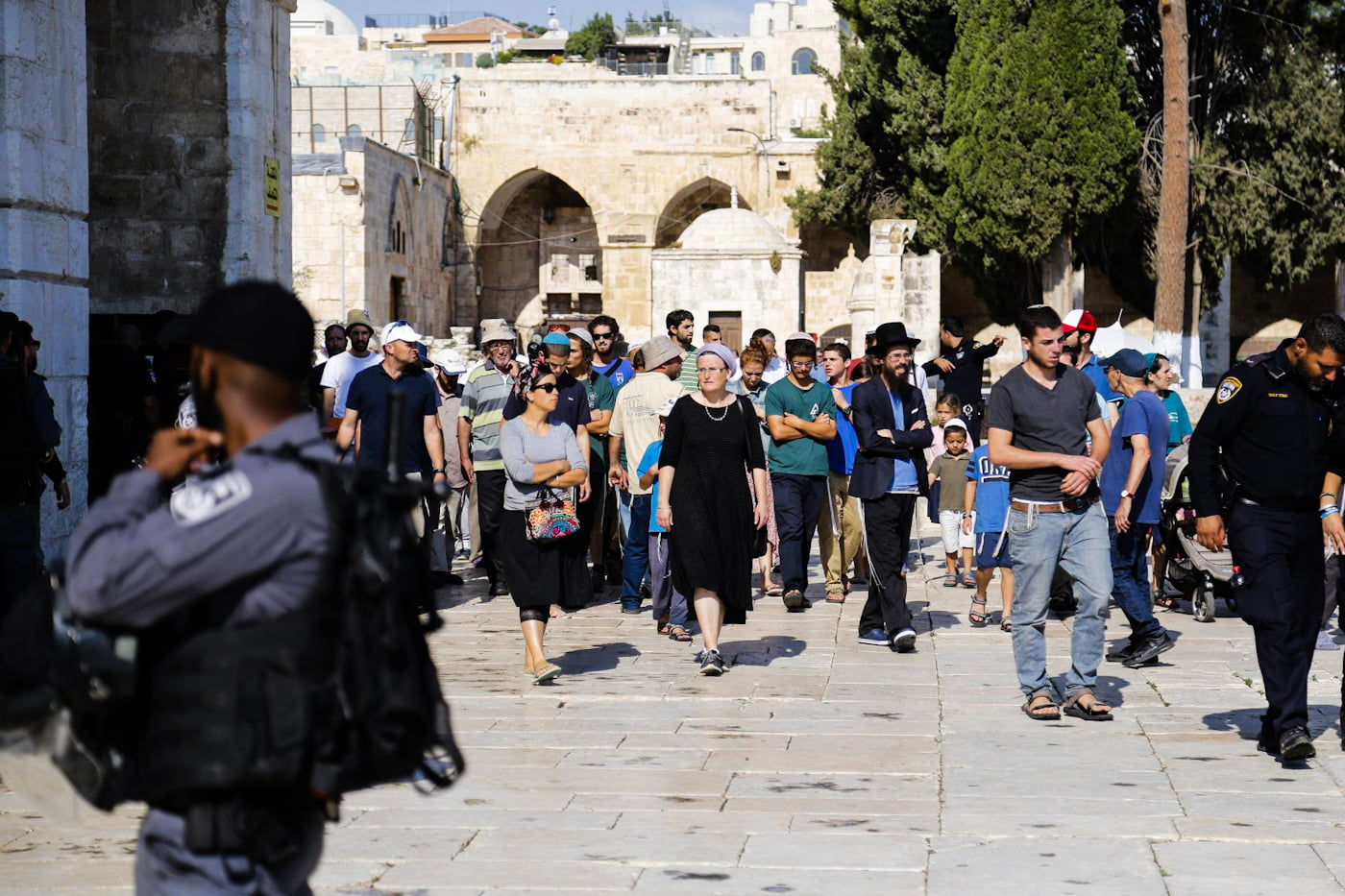 Extremist settlers escorted by Israeli after they stormed the Al-Aqsa Mosque compound on July 22, 2018. Mostafa Alkharouf | Anadolu