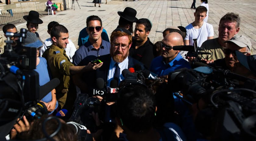 Israeli Knesset member Yehuda Glick, center, speaks to journalists after visiting at the Al Aqsa Mosque compound in Jerusalem, Aug. 29, 2017. Sebastian Scheiner | AP