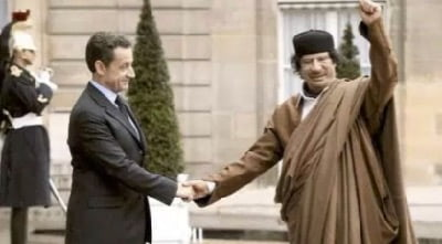 Having returned to the United States and complied with all of President Bush's demands, former revolutionary Muammar Gaddafi became honourable.