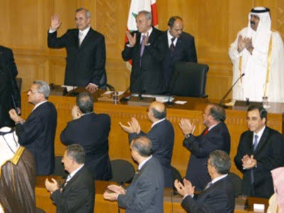 """Michel Sleimane (top left) takes an oath to defend Lebanon's """"independence"""" under the benevolent gaze of the Emir of Qatar (top right) who presided over the ceremony and the French Minister of Foreign Affairs who staged it."""