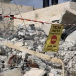 A sign stating 'Danger, demolition. Entry is prohibited' was placed by Israeli authorities on top of the rubble of the Khalialehs' houses (MEE\Sondus Ewies)